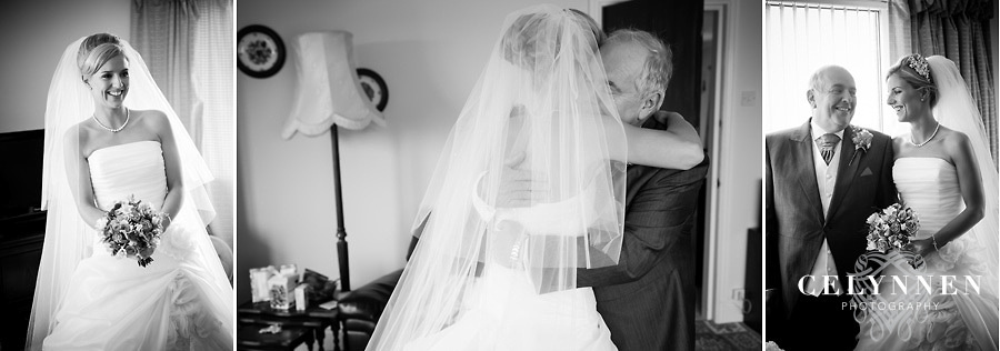 Bride and father of the bride hugging at the Meifod Country House, Caernarfon
