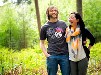 A couple laughing while enjoying a portrait photoshoot by Celynnen Photography in Delamere Forest, Cheshire