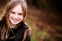 Portrait of a young girl taken in a park in Chester, Cheshire by portrait photographer Celynnen Photography