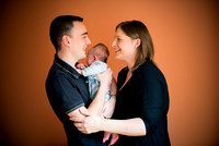 Parents cuddling their baby while enjoying a portrait photoshoot by Celynnen Photography in Ruthin