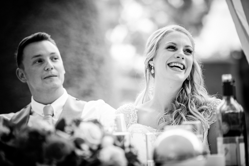 Black and white image of the bride enjoying the speeches at her wedding at Bodrhyddan Hall.