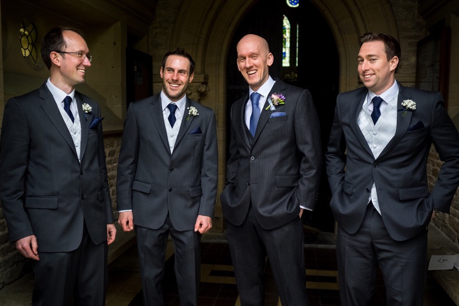 A photograph of Ross, his Best Man & Ushers waiting at the door of St John the Evangelist Church in Rhydymwyn .