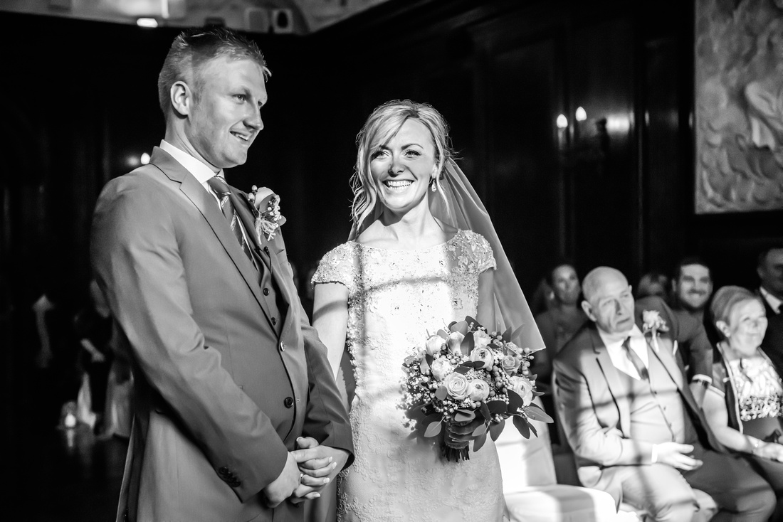 Black and white image of the bride and groom enjoying themselves during the wedding ceremony in Portmeirion.