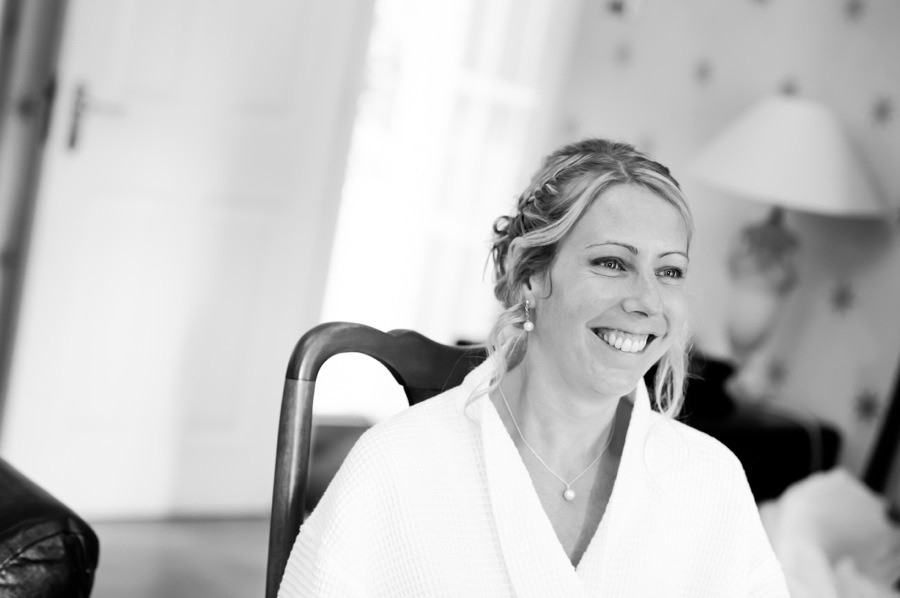 bride smiling, getting ready at her wedding in Portmeirion. Wedding photographer, Celynnen Photography