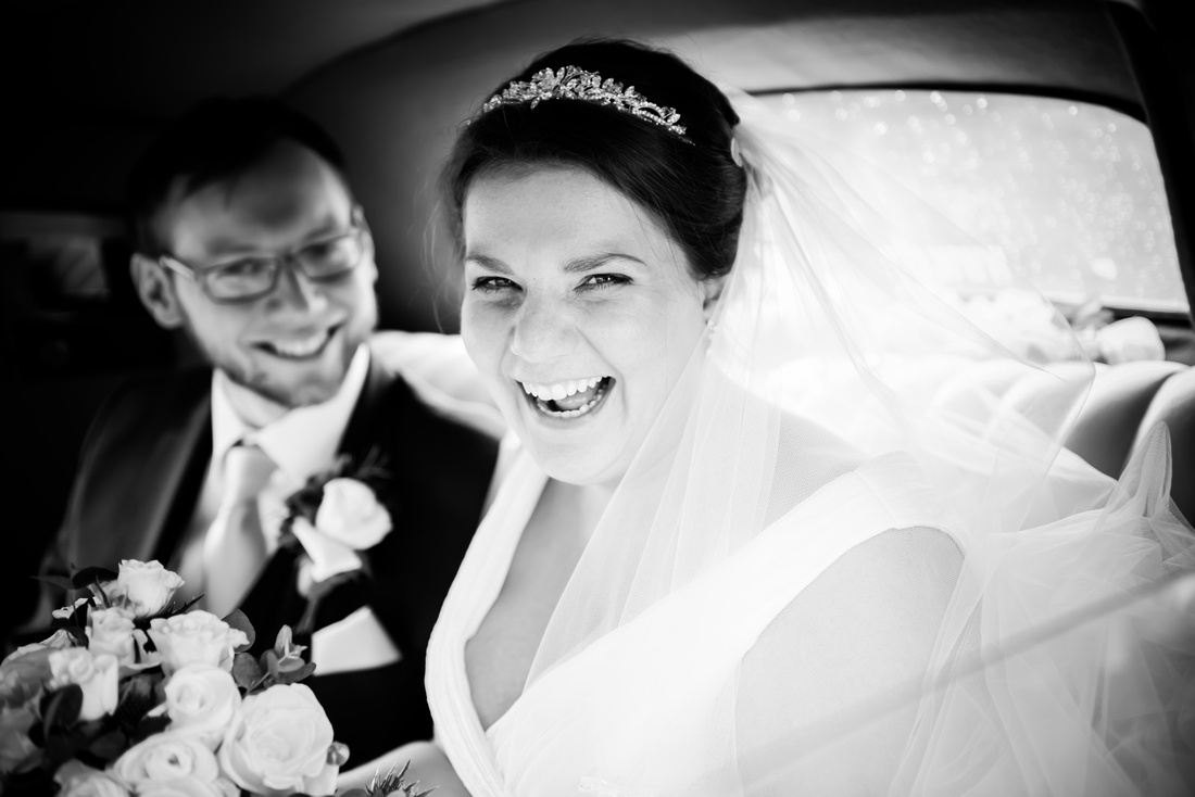 Black and white image of a happy bride after their wedding ceremony.