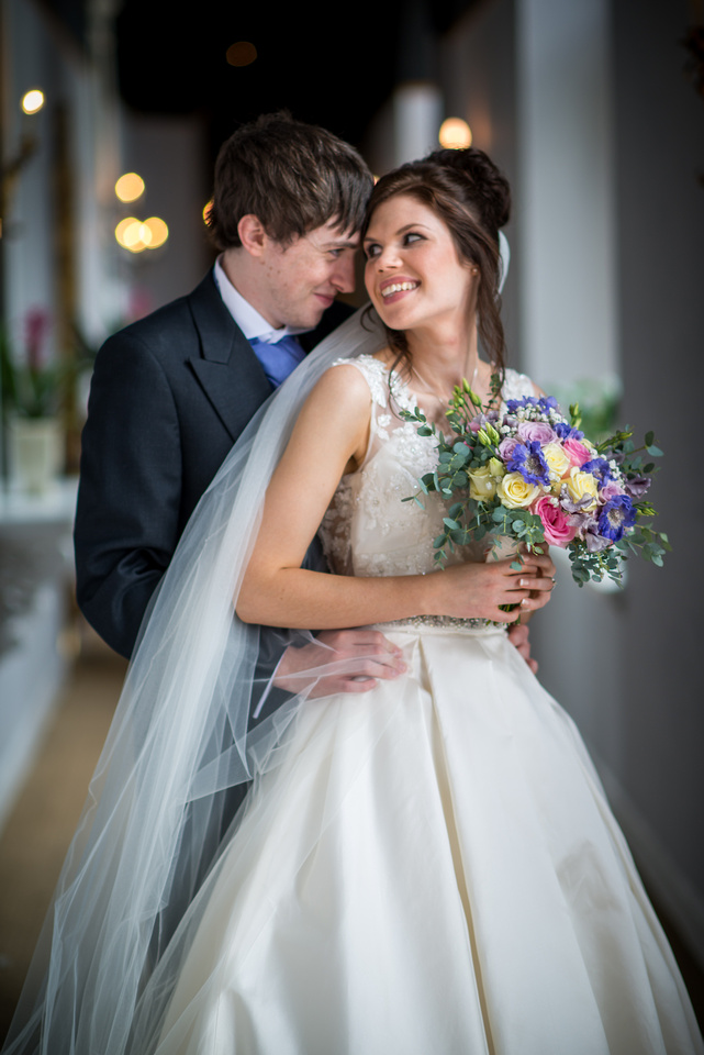 Photo of bride and groom looking into each other's eyes, at Ruthin Castle.
