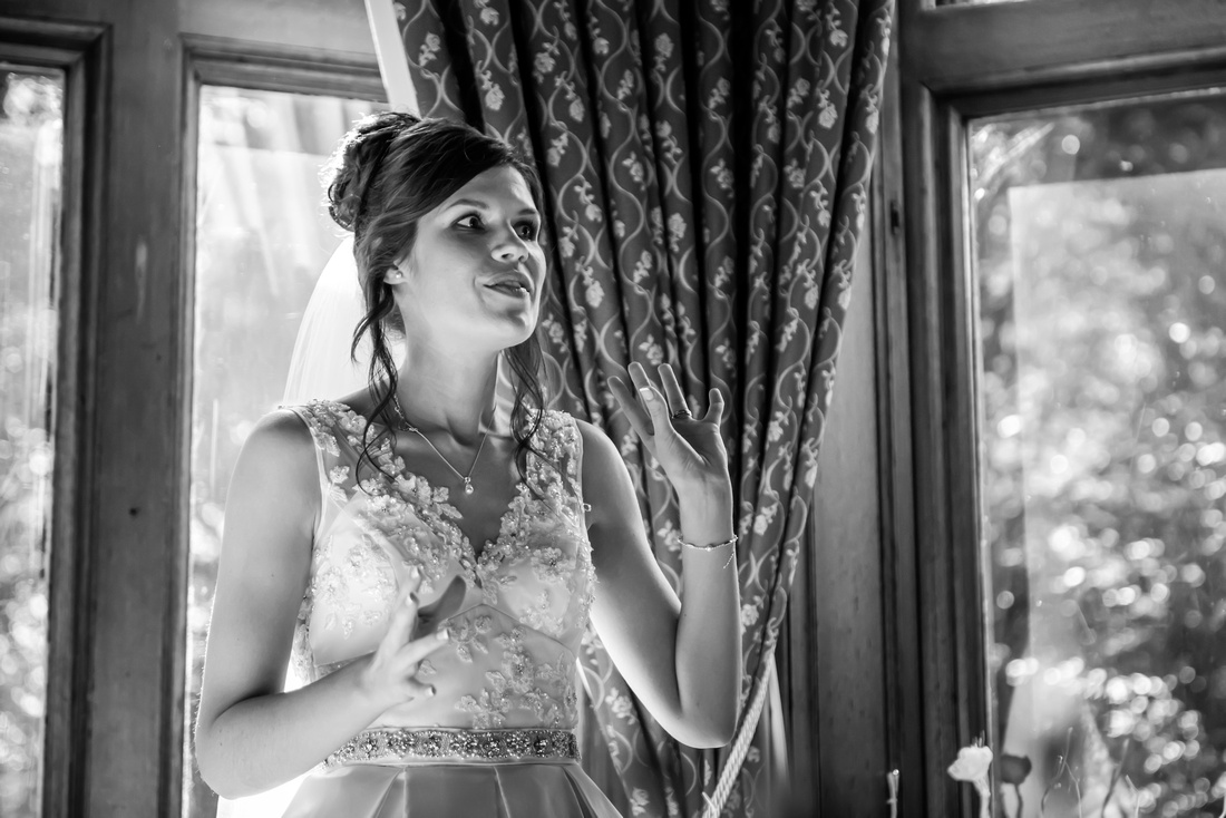 Black and white image of the bride giving a speech at her wedding at Ruthin Castle.
