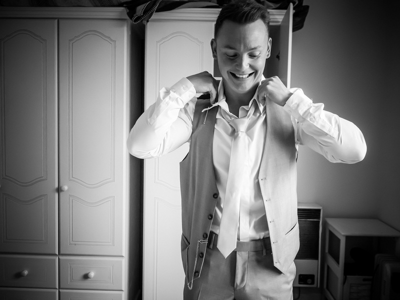 Black and white image of the groom getting ready for his wedding day at Bodrhyddan Hall