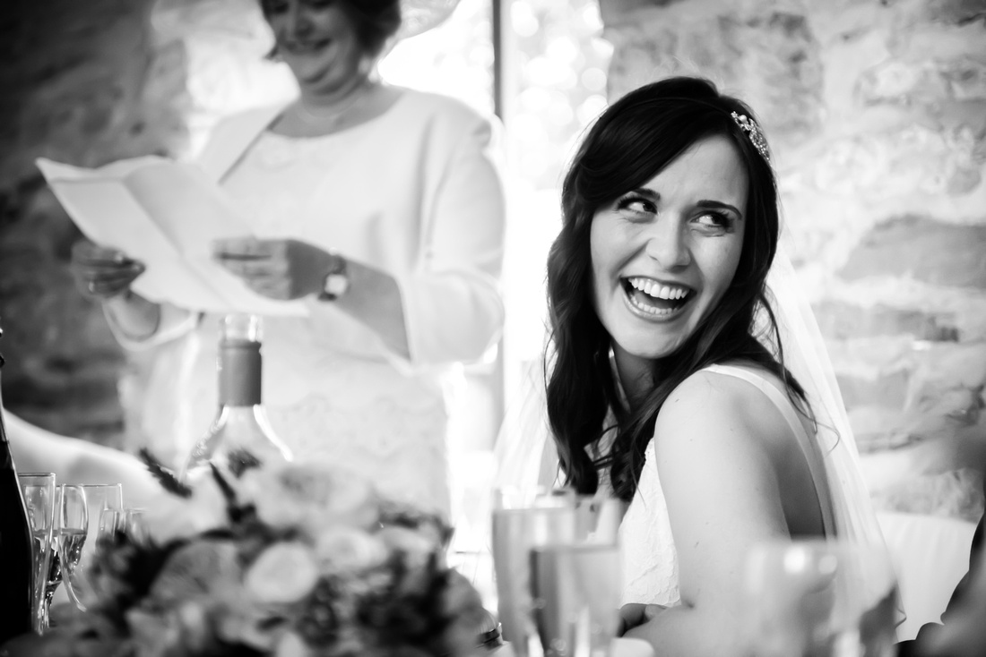 Black and white image of the bride during the mother of the bride's speech at Plas Isaf.