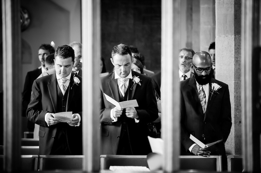 Black and white image of the ushers during the wedding ceremony in Chester