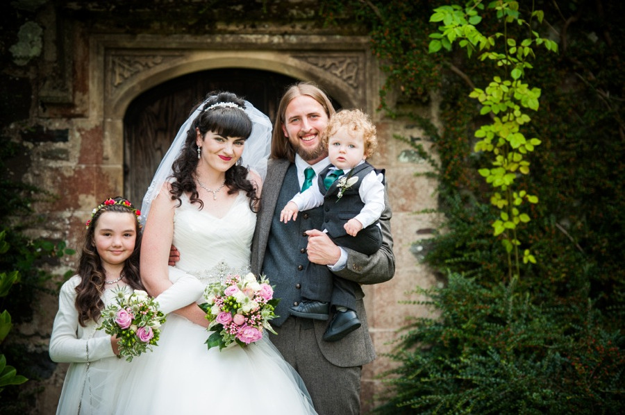 Bride, groom and their two children on their wedding day at Gwydir Castle, by Celynnen Photography, North Wales wedding photographer of the year