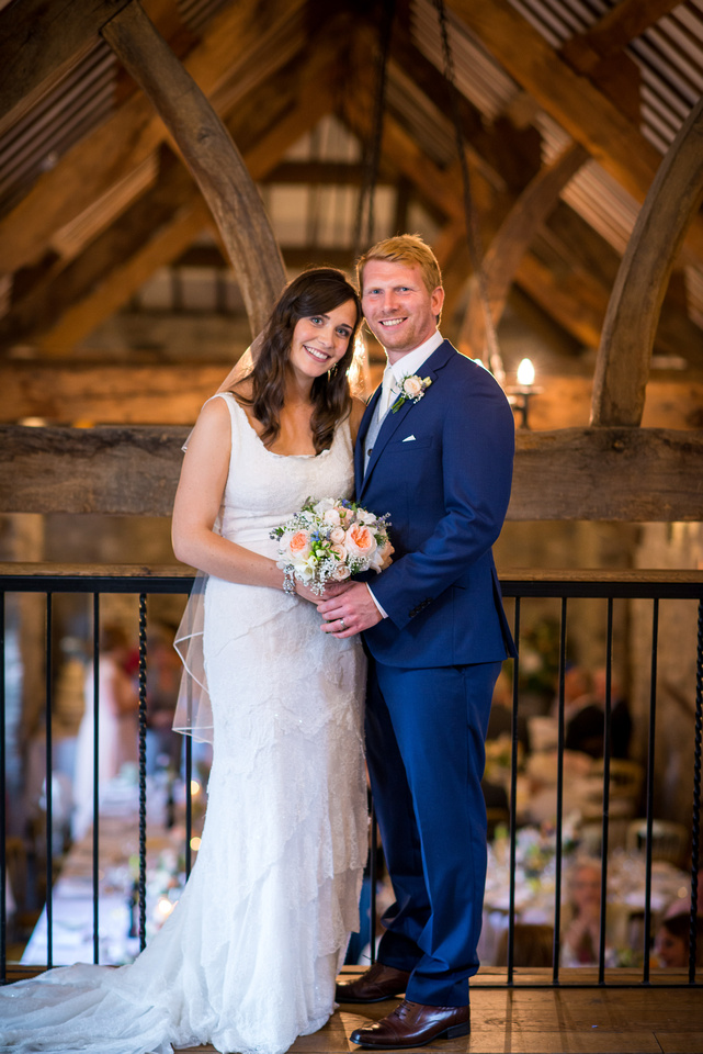 Bride and groom standing upstairs in Plas Isaf, Corwen by wedding photographer Celynnen Photography