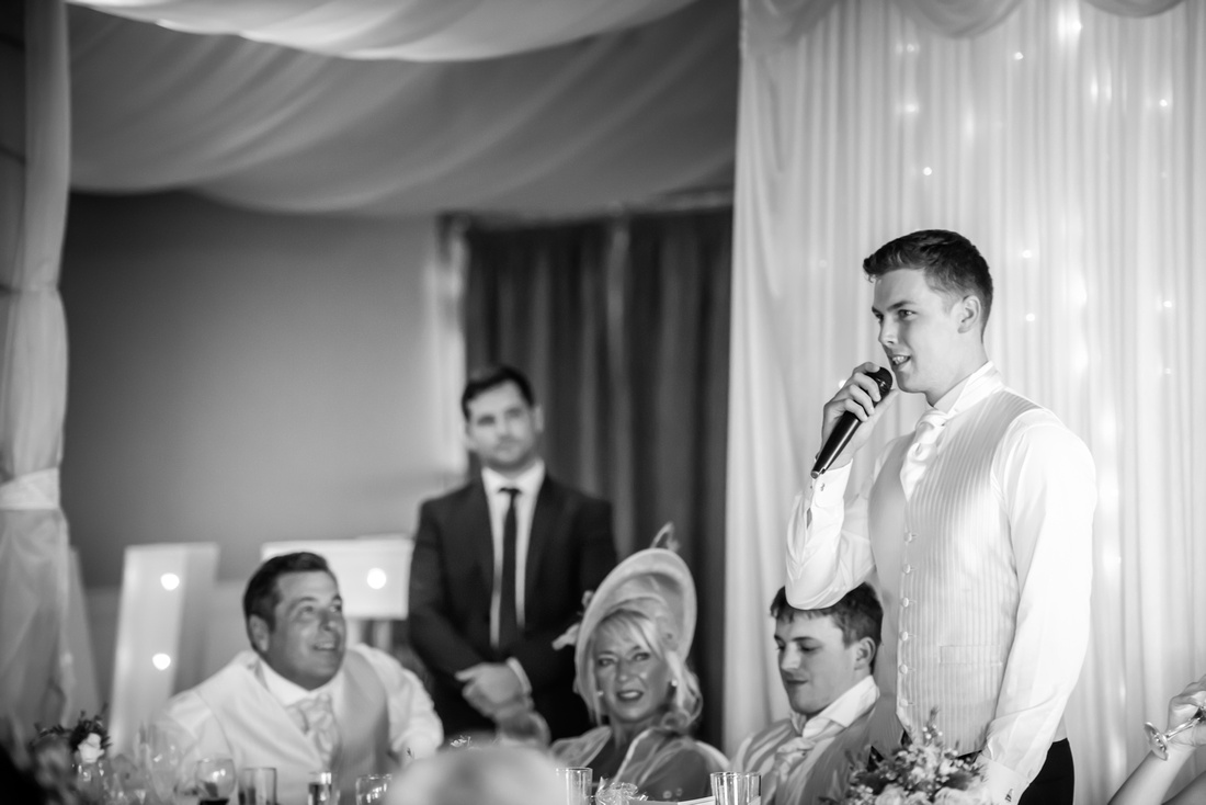 Black and white image of groom giving his speech at the reception at The Kinmel.