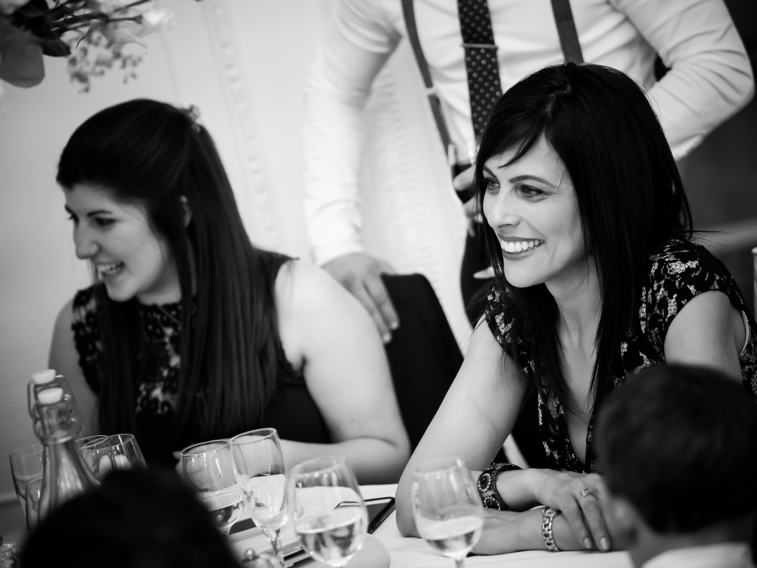 Black and white image of some guests at a wedding in Buckinghamshire.