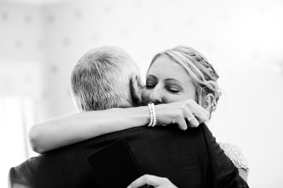 Bride hugging her father. wedding in Portmeirion. Wedding photographer, Celynnen Photography