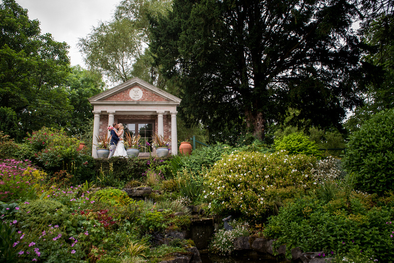 Image of the bride and groom in the colourful grounds of Bodrhyddan Hall.
