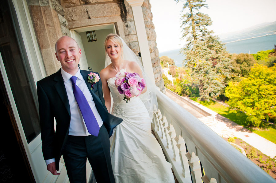 bride and groom at plas rhianfa overlooking the menai strait by celynnen photography