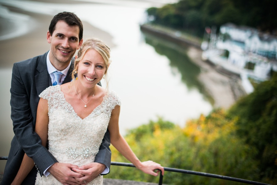 Bride and groom overlooking the hotel at their wedding in Portmeirion. Wedding Photographer, Celynnen Photography