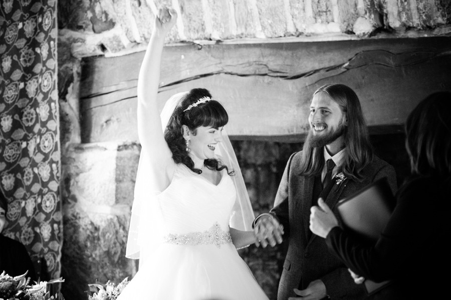 bride cheering during her wedding at Gwydir Castle. North Wales Wedding photographer, Celynnen Photography