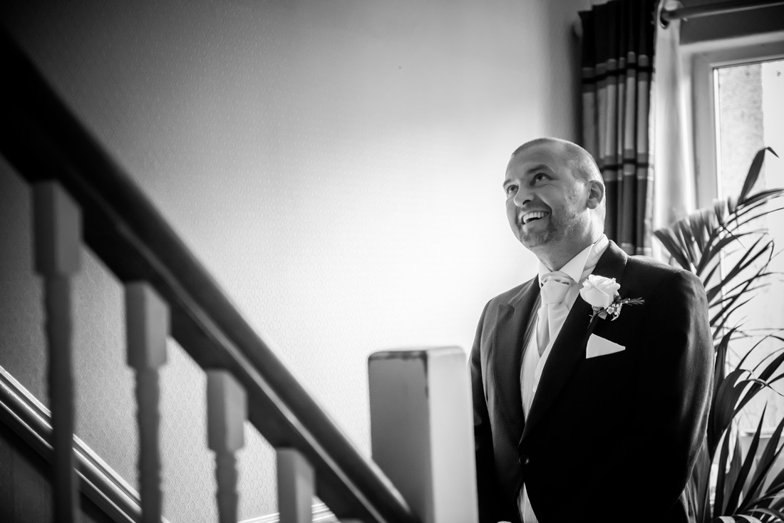 Black and white picture of the father of the bride first seeing his daughter as a bride. Wedding at The Kinmel near Abergele.