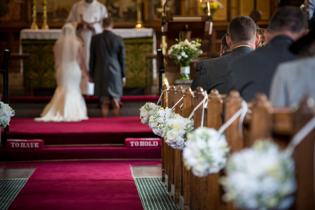 Image of the church setting during a wedding ceremony. Church location is in Halkyn.