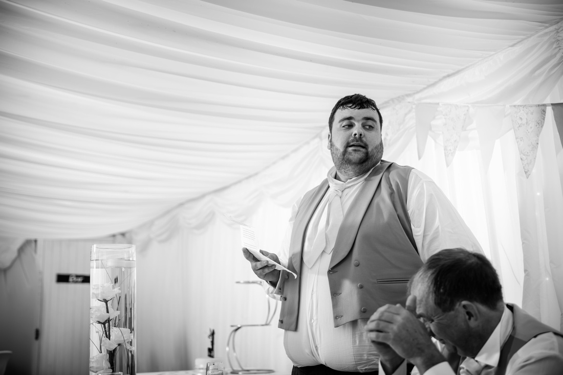 Black and white image of the best man giving his speech at a wedding at Pentre Mawr.