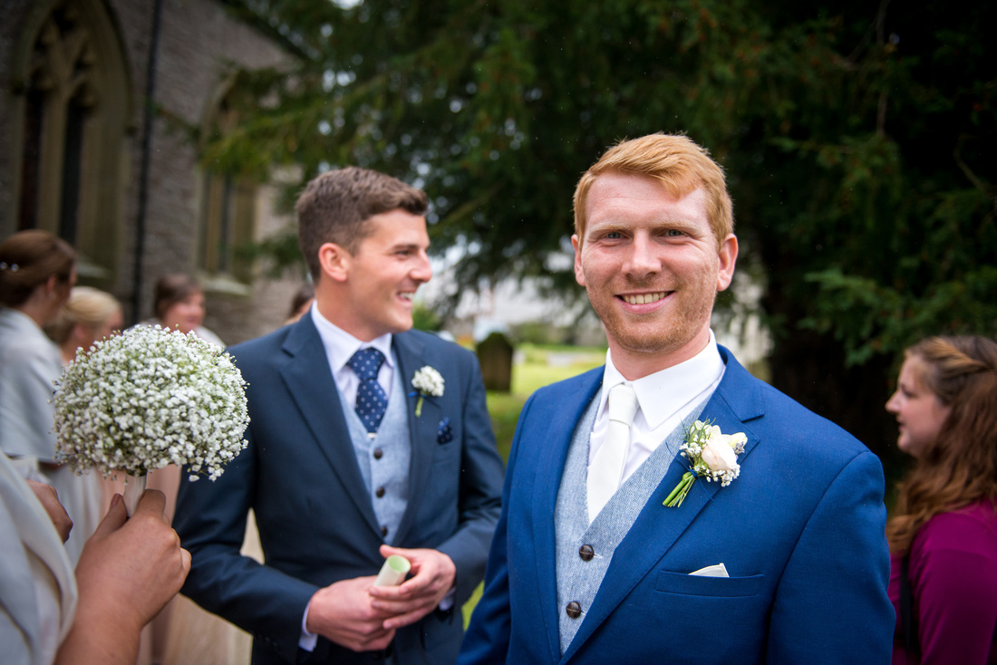 Image of the groom after his wedding ceremony in a church in Llandegla.