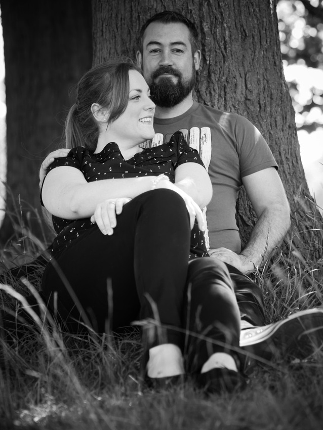 Photograph of Claire & Paul sitting against a tree in Sefton Pak, Liverpool.  Taken in black & white.
