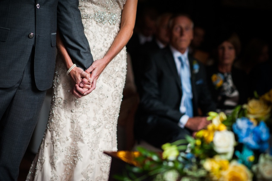 bride and groom holding hands at a wedding in Portmeirion. Wedding photographer, Celynnen Photography