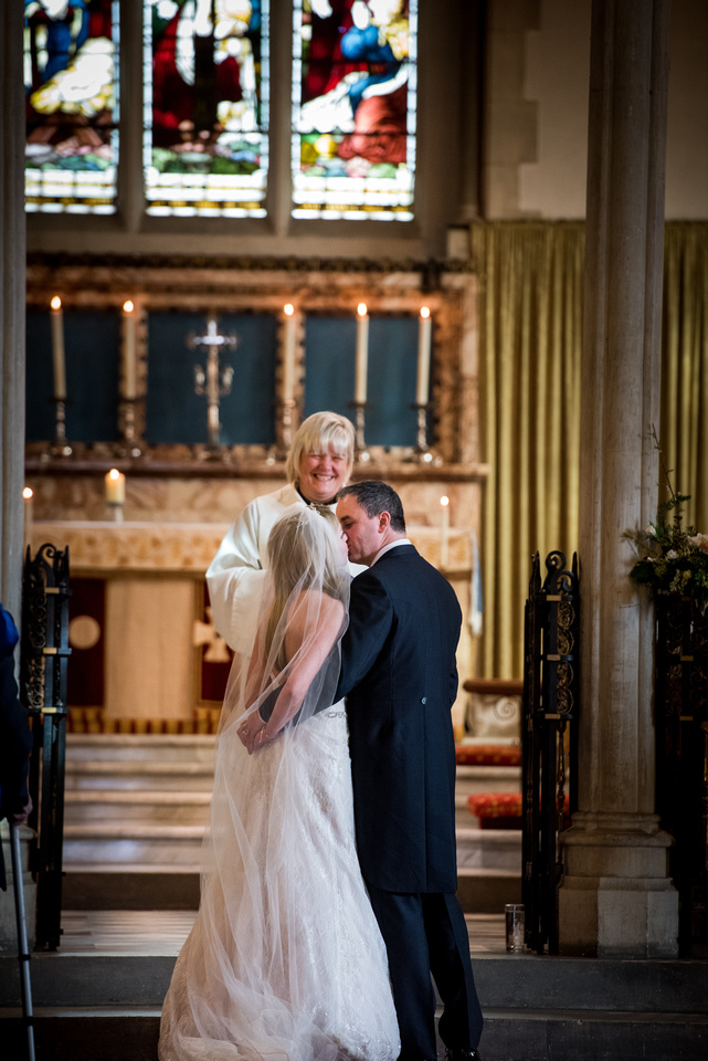 Image of the bride and groom sharing a kiss in a church in Buckinghamshire