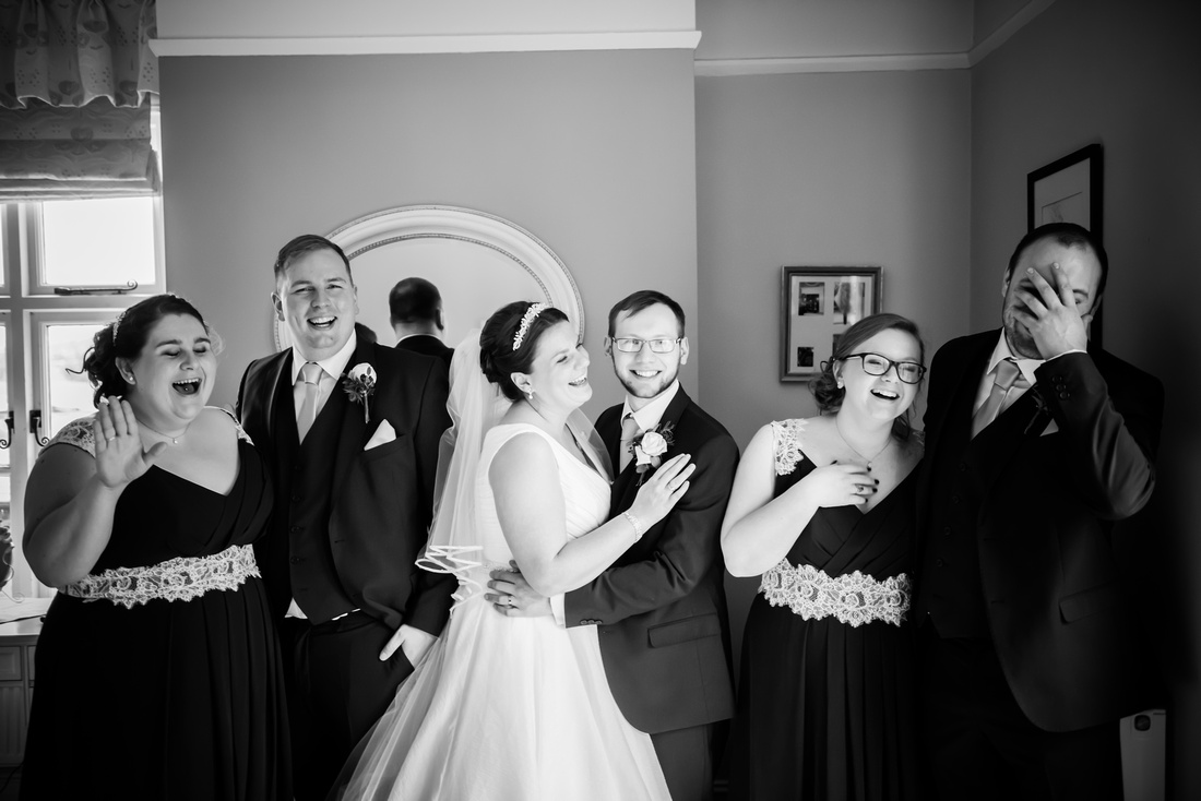 Black and white portrait of all the bridal party at Mere Brook House.