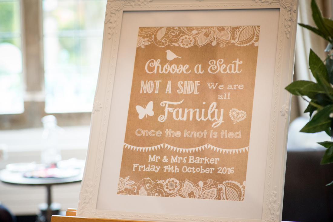 A photograph of a framed sign for the wedding ceremony which was in Portmeirion.