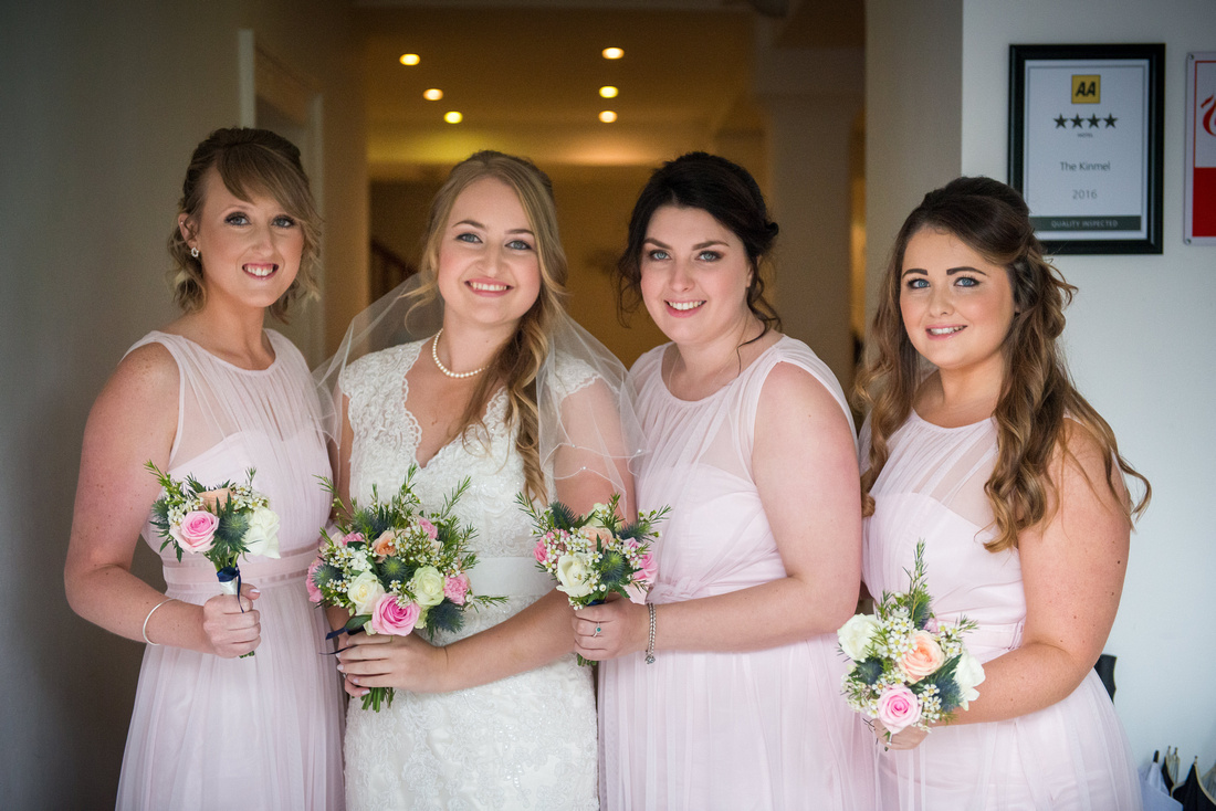 Photograph of the bride and her bridesmaids before the wedding ceremony at The Kinmel.
