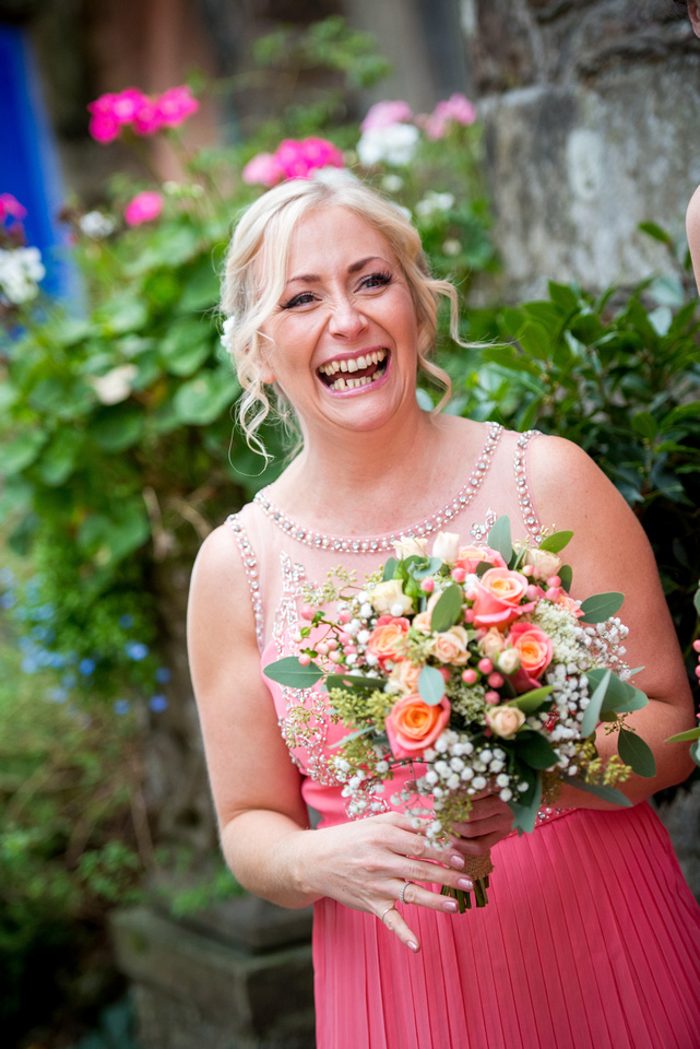 Portrait of a very happy bridesmaid at a wedding in Portmeirion.