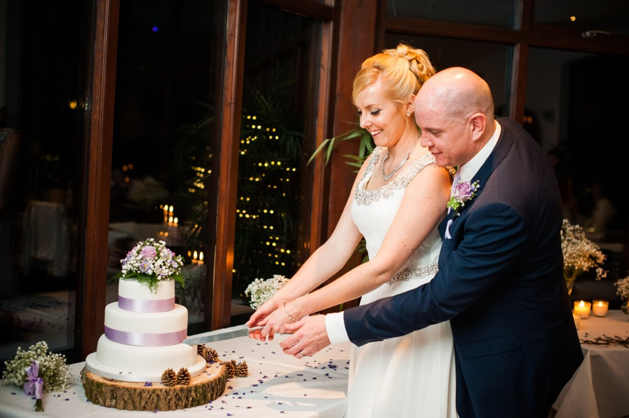 Bride and Groom cutting the cake by North Wales Wedding Photographer Celynnen Photography