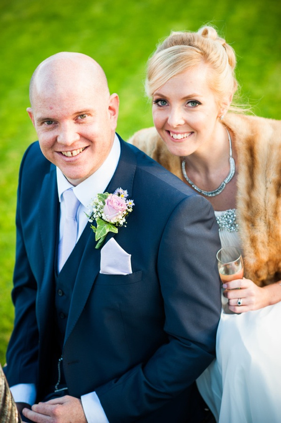 Bride and Groom smiling together by North Wales Wedding Photographer Celynnen Photography