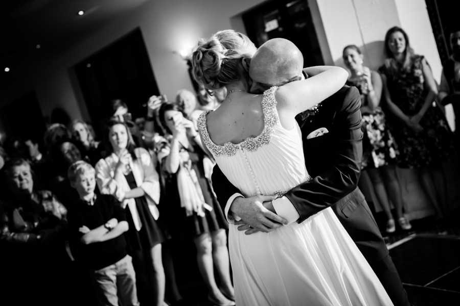 Bride and Groom hugging during first dance by North Wales Wedding Photographer Celynnen Photography