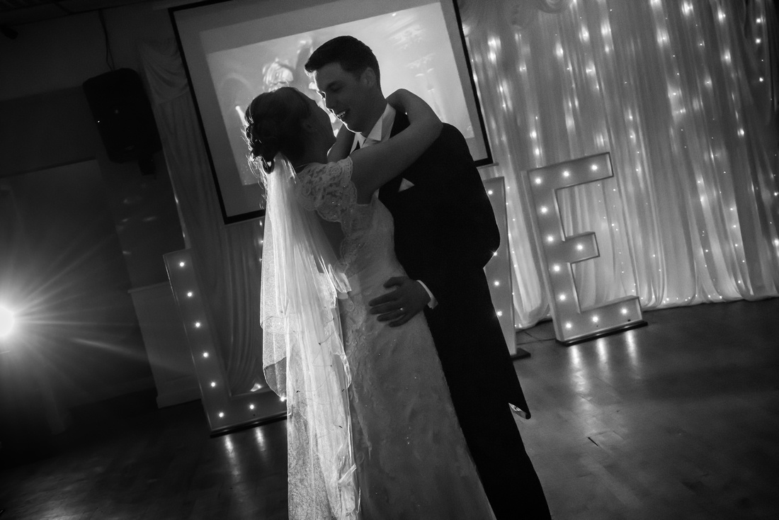 Black and white image of bride and groom enjoying their first dance as a married couple at The Kinmel.