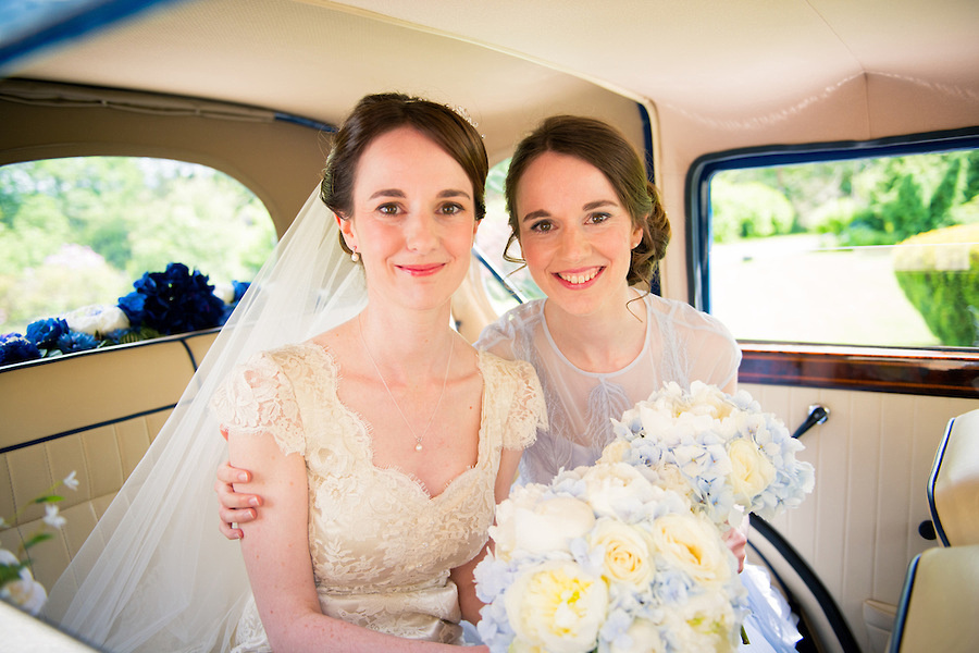 A bride and her bridesmaid before the wedding, at Plas Hafod.