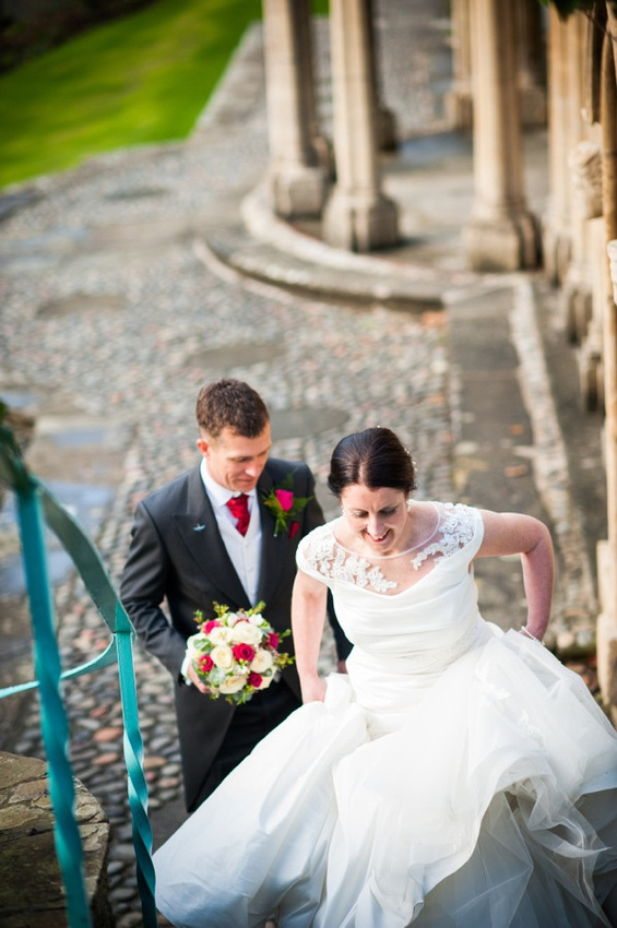Bride and Groom walking up steps by Wedding Photographer Celynnen Photography