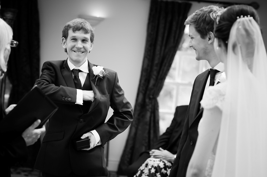 Black and white image of the best man getting the wedding rings for a wedding at Plas Hafod.