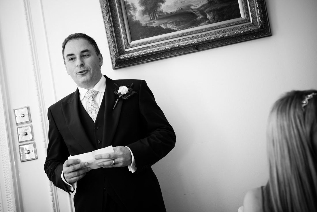 Black and white image of the groom during his speech at a wedding in Buckinghamshire.