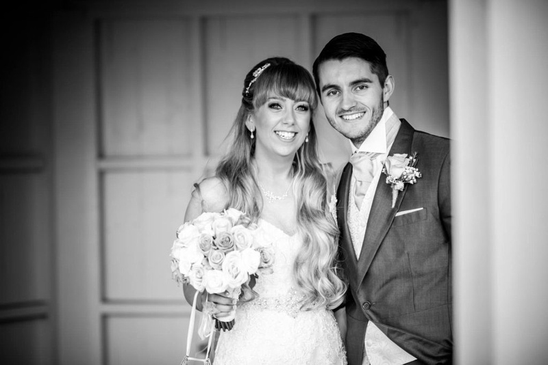 Bride and groom smiling at their wedding in the lion quays, Oswestry