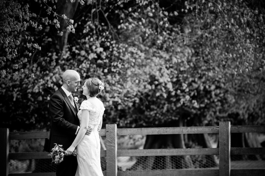 Black & White shot of Ross & Mair, photographed in the grounds of Soughton Hall on their wedding day by Celynnen Photography.