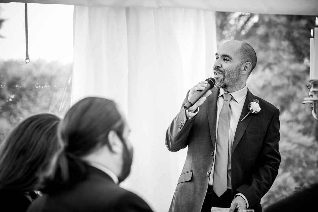 Black and white image of the groom giving his speech at a wedding at Soughton Hall.