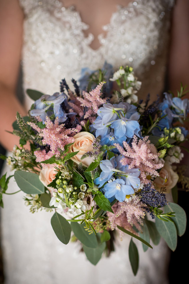 Colourful image of the bride's bouquet for her wedding at Tower Hill Barns.