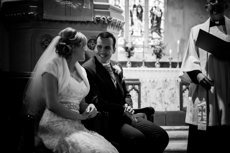 Bride and Groom Smiling at Altar by North Wales Wedding Photographer Celynnen Photography