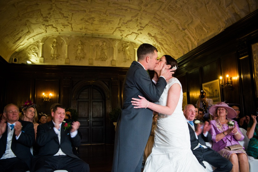 Bride and Groom Kiss at Wedding in Portmeirion by Photographer Celynnen Photography