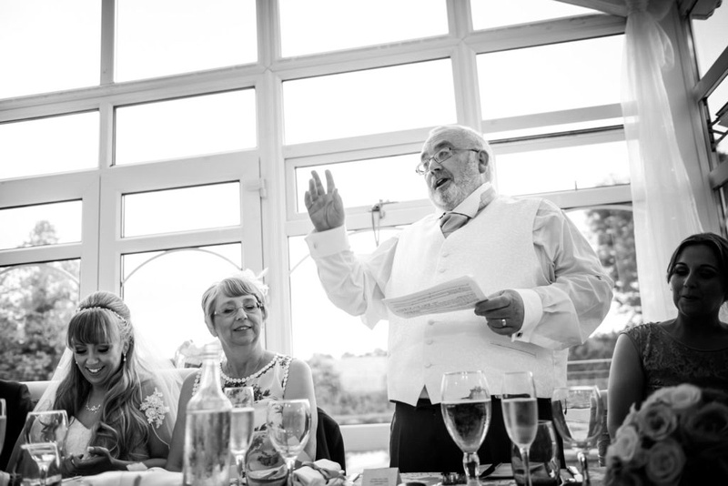 Black and white image of the father of the bride giving a speech at his daughters wedding at The Lion Quays.