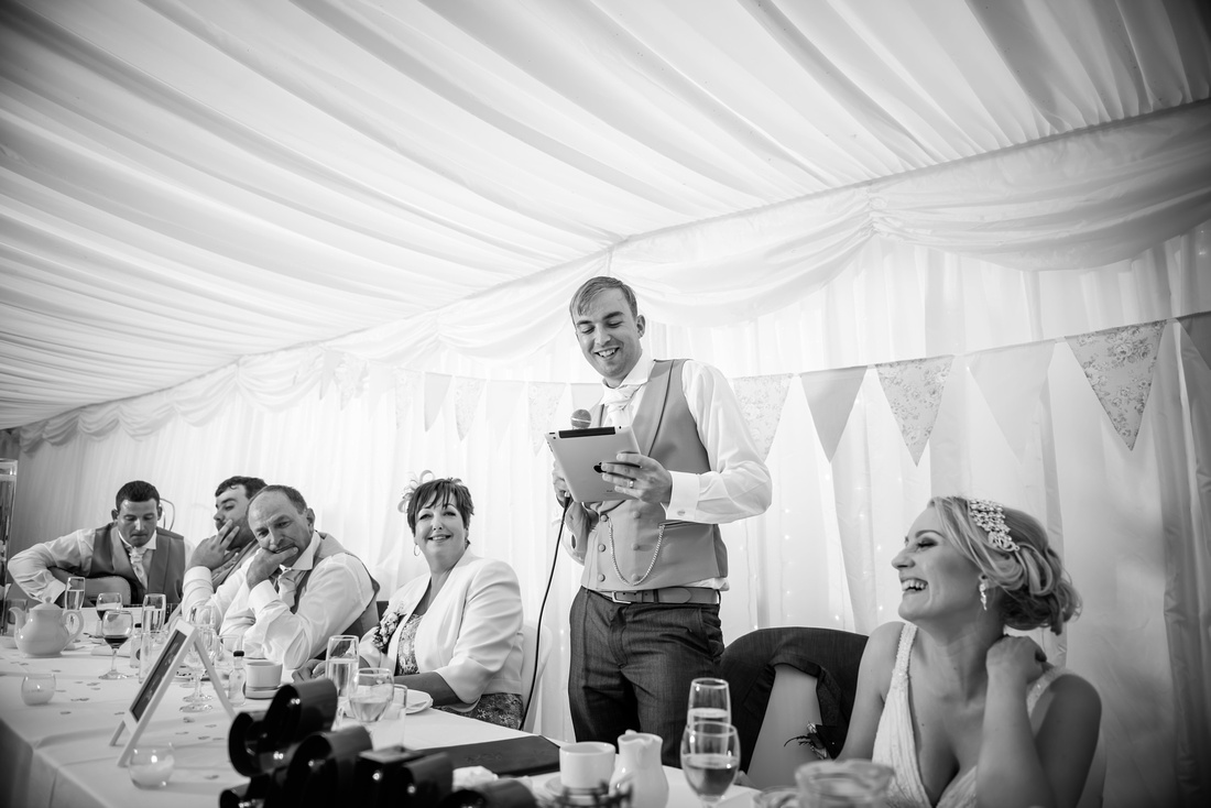 Black and white image of the groom giving his speech at his wedding at Pentre Mawr.